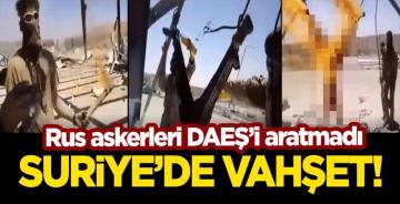 Suriye'de vahşet görüntüleri! Rus askerleri başını ve ellerini kestiği adamı ateşe vererek yaktı!